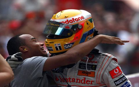 Lewis Hamilton gets a hug from his brother, Nick.