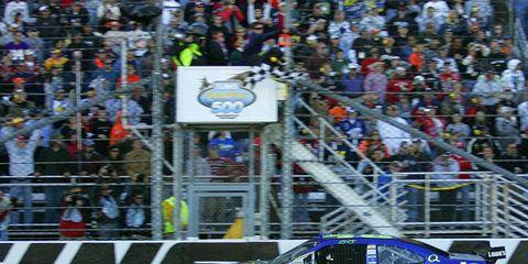 Jimmie Johnson crosses the finish line.