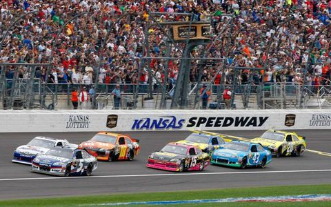 Kasey Kahne leads the field at the start in Kansas on Sunday.