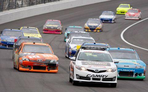 Kyle Busch and Aric Almirola follow the pace car at Kansas.