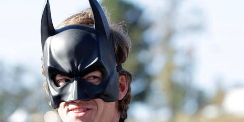 Nissan DeltaWing driver Lucas Ordonez poses in a Batman costume while greeting fans before the start of Petit Le Mans on Saturday. Ordonez  helped drive the revolutionary race car to a sixth place finish in the race.