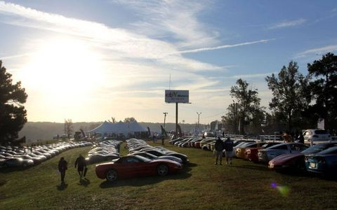 The morning sun rises over a field of Chevrolet Corvettes parked in an infield corral at the Road Atlanta track for the Petit Le Mans in Braselton, Ga., on Saturday.