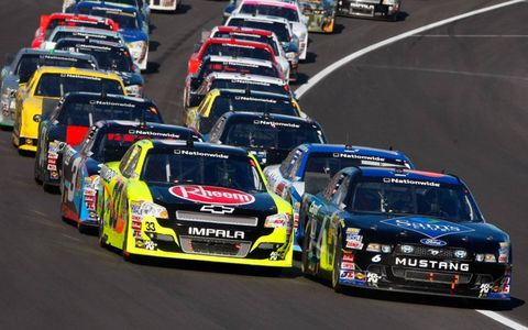 Ricky Stenhouse Jr., right, and Paul Menard lead the Nationwide Series pack at Kansas Speedway.