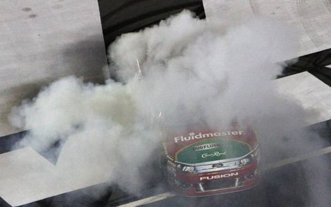 Celebration // Matt Kenseth does a burnout after winning the NASCAR Sprint Cup race at Charlotte Motor Speedway on Oct. 15. Photo by: LAT Photographic