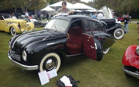 Justin Pinot's gleaming black 1960 Tatra Tatraplan gets a final rubdown as the show field fills.