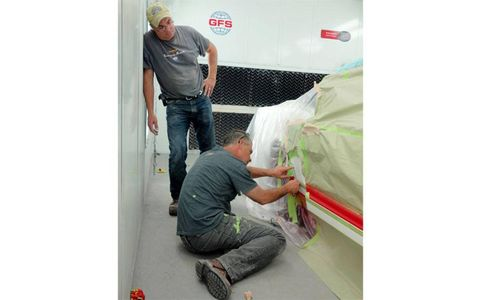 The guys add a coat of the Blizzard White BASF Glasurit Waterborne paint.