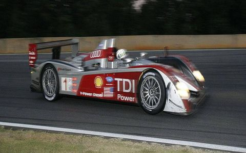 The number 1 Audi R10 P1 car circles the track as the light falls during the Petit Le Mans at Road Atlanta in Braselton, Ga., on Saturday, Oct. 4, 2008.