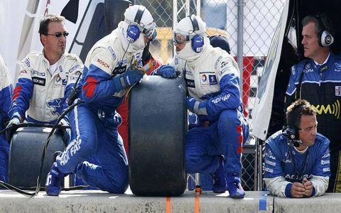 Crew members for the Peugeot 908 HDi car confer on pit road during the Petit Le Mans at Road Atlanta in Braselton, Ga., on Saturday, Oct. 4, 2008.