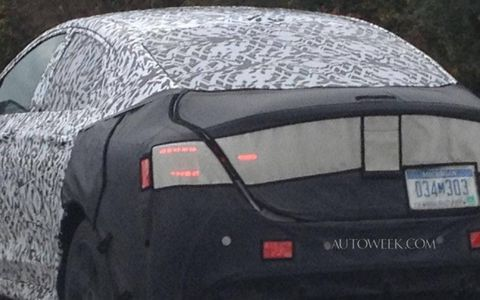 Rear view of the 2015 Chrysler 200 cloaked in camouflage