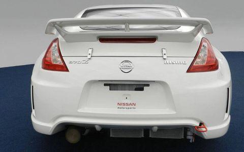 Automotive tail & brake light, Automotive design, Vehicle, Automotive exterior, Car, Automotive lighting, Red, White, Trunk, Bumper,