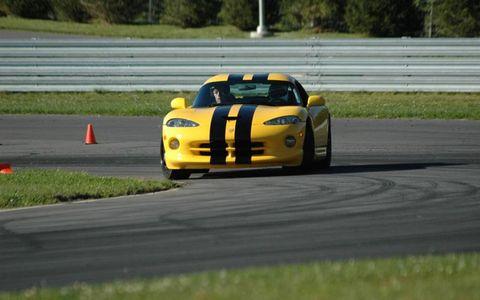 Road, Automotive design, Vehicle, Sports car racing, Infrastructure, Race track, Road surface, Asphalt, Motorsport, Car,