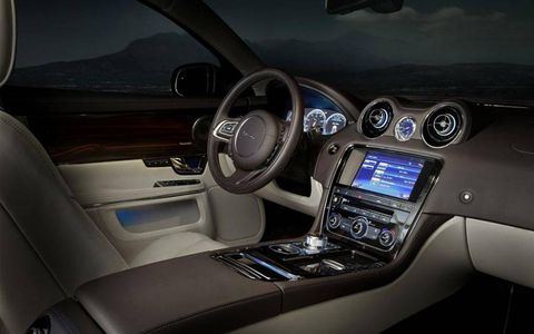 Interior details, like wraparound dash trim made of wood and leather, give occupants of the 2012 Jaguar XJL Portfolio the feeling of being in a classic Chris-Craft speedboat.