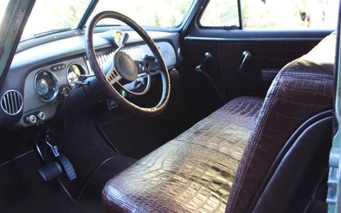Alligator and buffalo leather cover the interior.