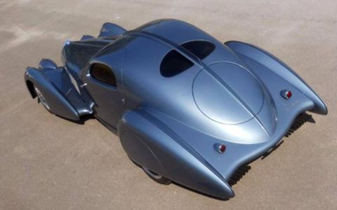"""Since the Delahaye USA Pacific is a """"recreation"""" rather than a """"replicar,"""" designers had some room to play around with lines. For what it's worth, the decorative vertical spine on the the real Bugatti Atlantic was equally ornamental."""