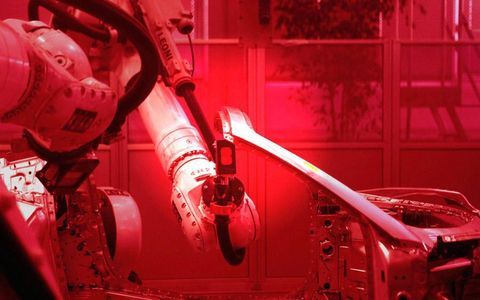 Robots perform up to 40 percent of the assembly work at Scaglietti, including this one using cold metal transfer welding technology.