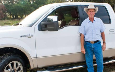 President Bush stands next to his 2009 Ford F-150. The truck will be auctioned by Barrett-Jackson.