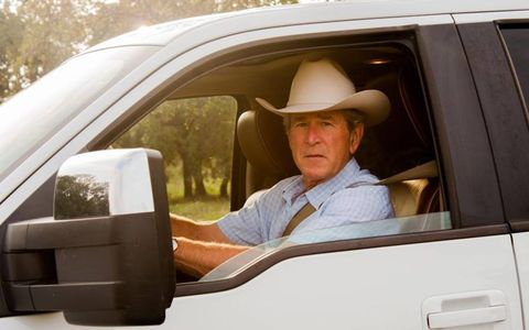 President Bush looks out over his ranch from his F-150.