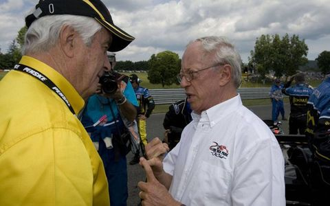 Skip Barber, right, with Roger Penske, founded a driving school that started many drivers on the road to championships.