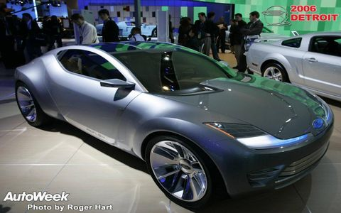 Tire, Wheel, Mode of transport, Automotive design, Land vehicle, Vehicle, Event, Car, Auto show, Exhibition,