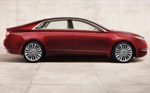 Tire, Wheel, Automotive design, Vehicle, Car, Alloy wheel, Red, Rim, Full-size car, Mid-size car,