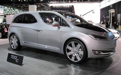 Tire, Wheel, Motor vehicle, Mode of transport, Automotive design, Vehicle, Land vehicle, Event, Automotive wheel system, Car,