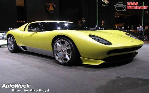 Tire, Wheel, Motor vehicle, Automotive design, Mode of transport, Vehicle, Yellow, Land vehicle, Car, Performance car,