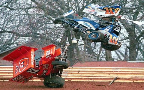 The Super Sprint car driven by Jeremy Campbell of Monroe, Michigan, sails through the air after colliding with a car driven by Greg Hodnett of Memphis, Tennessee, while racing at Williams Grove Speedway near Mechaniscburg, Pennsylvania, on April 1, 2001. Neither driver is seriously injured.