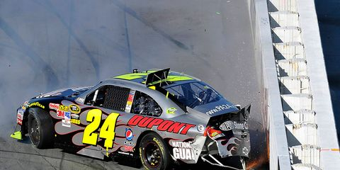 Jeff Gordon has had his share of crashes both with and without the benefit of the energy-absorbing SAFER barriers. Here, Gordon bangs hard into a SAFER barrier at Martinsville Speedway in 2010.