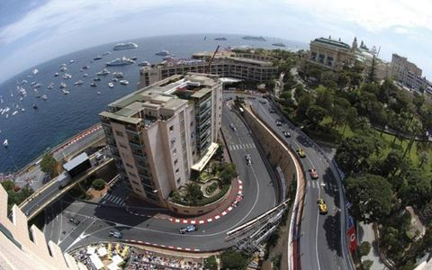 McLaren's Kimi Raikkonen leads the F1 field in Monaco on his way to the win, but eventual champion Fernando Alonso had already built a big points lead. Both left reigning champ Michael Schumacher in their wake.