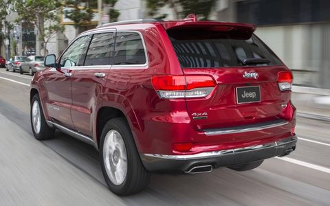 A rear-side view of the 2014 Jeep Grand Cherokee Summit.