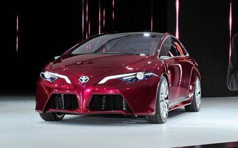 Automotive design, Mode of transport, Event, Transport, Automotive lighting, Car, Red, Rim, Personal luxury car, Performance car,