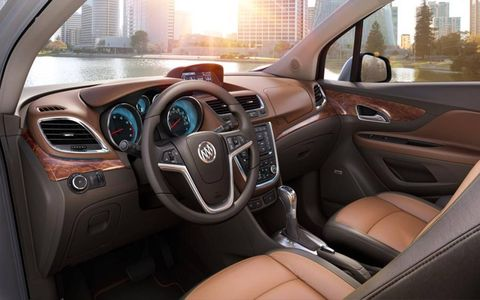 Motor vehicle, Steering part, Steering wheel, Automotive design, Brown, Automotive mirror, Transport, Center console, Vehicle door, Car,