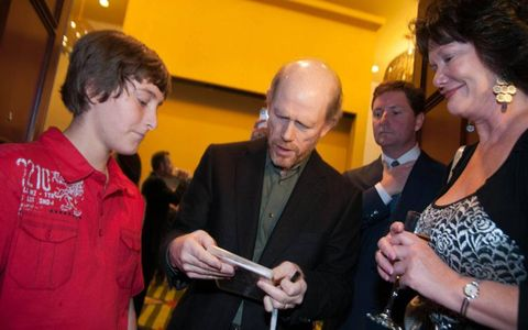 Ron Howard, center, signs autographs for fans during his visit to Austin, Texas, on Thursday.