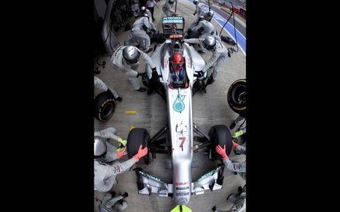 2012 Indian Grand Prix: Michael Schumacher, Mercedes F1 W03, makes a stop.