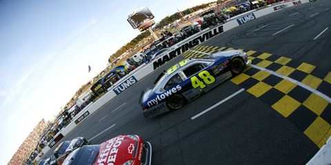Tony Stewart and Jimmie Johnson go side-by-side down the front strecth at Martinsville Speedway in Martinsville, Va., on Oct. 30. Photo by: LAT Photographic