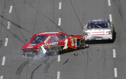 The No. 1 of Jamie McMurray crashes into Brian Vickers. Photo by: LAT Photographic