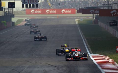 The McLaren of Jenson Button leads Red Bull Racing's Mark Webber. Photo by: Andrew Ferraro/LAT Photographic