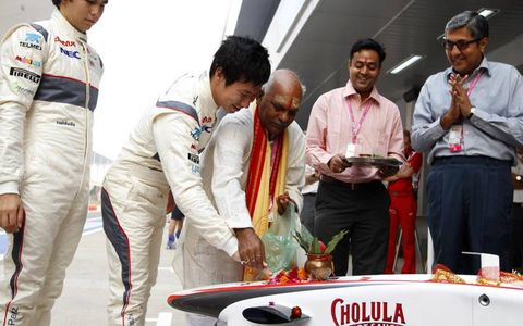 Welcome Wagon: Sauber Formula One drivers Sergio Pérez (left) and Kamui Kobayashi take part in an Indian blessing ceremony during the country's inaugural Grand Prix weekend.