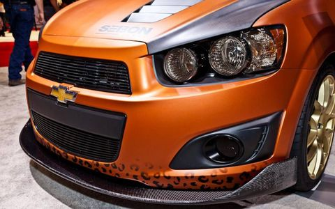 Closeup of the chin spoiler and leopard details of the LDRSHP Chevy Sonic at SEMA.