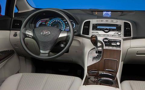 Motor vehicle, Mode of transport, Steering part, Product, Transport, Automotive design, Vehicle, Steering wheel, White, Technology,