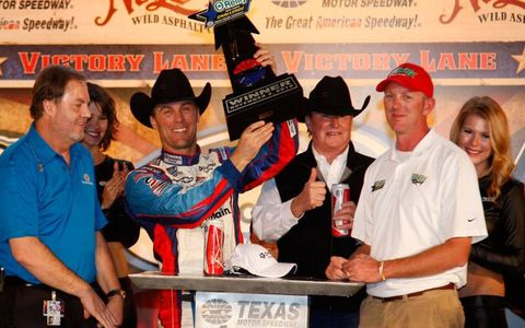 Kevin Harvick celebrates in victory lane at Texas on Saturday night.