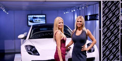 The ladies of CEC Wheels show off the new Fisker Karma Reserve, the exclusive tuner for the Fisker brand.