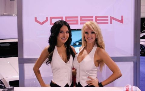 Katie and Kat welcome visitors to the Vossen Wheels booth at SEMA 2011.