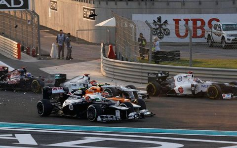 Bruno Senna (19) and Nico Hulkenberg make contact during Sunday's Abu Dhabi Grand Prix.