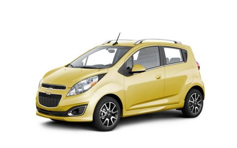 The Chevy Spark can seat up to four and offers more space than the similarly sized Scion iQ.