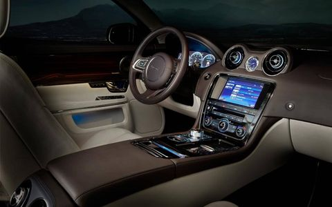 Inside the Jaguar XJ Portfolio sedan; LCD displays form the instruments and center stack controls.