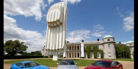 A giant Jaguar E-type sculpture has been set up at Goodwood House.