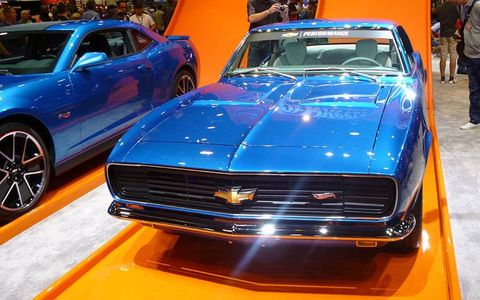 Chevrolet customized a 1967 Camaro in a Hot Wheels theme for SEMA. It will also offer a Hot Wheels package on the 2013 model (left).