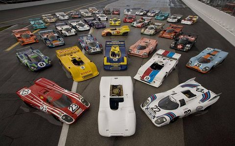 An array of Porsche 917 and 956/962 endurance racers is fronted by the Le Mans-winning Porsche 917Ks from 1970 (red) and 1971 (white) flanking the un-raced prototype Can Am Spyder with its 16-cylinder engine, making its first appearance in North America.