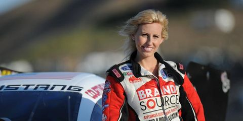 Courtney Force is the youngest daughter of drag-racing legend John Force.